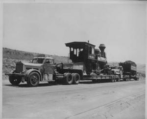 1940s Trucks Hauling Steam Train & Wood Car Press Photo 0002 - Belyea Truck Co