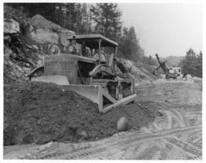 1950s Sterling Dump Truck with International Dozer Foreground Press Photo 0036