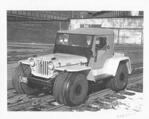 1957 Willys Jeep With Wide Tires on Railroad Tracks Press Photo 0007